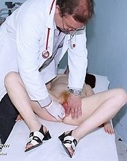 Mature redhead Olga with hairy pussy gets two speculum in her pussy by gyno doctor