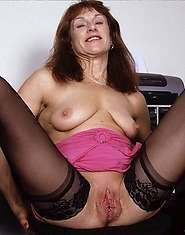 MILF likes showing her pussy at the office parties