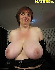 Big titted mature nympho showing her boobs