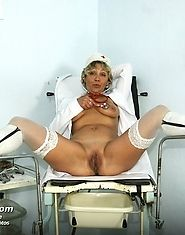 Mature nurse Vanda pussy gaping with speculum on gyno chair