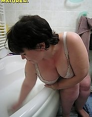 see this chubby mature have fun with a dildo