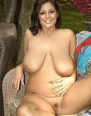 Gorgeous big busted brunette outdoors