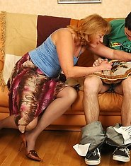 Freaky mature chick going out of control fucking young guy right on sofa