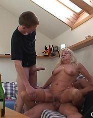 Granny with the big saggy tits is fucked by two guys at the same time and creamed