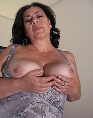 take a look at this horny mature housewife