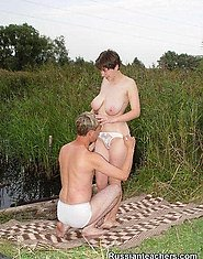 A guy seduces a hot brunette by a beautiful lakeside