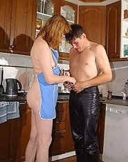 A naked girl seduces her teacher in the kitchen