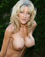 Blonde busty mature Lexi Carrington showing her great boobs outdoor