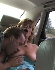 Sucking two guys off in a driving car