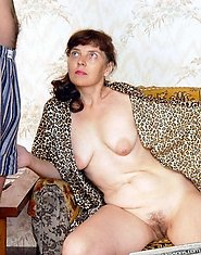 A horny mom seduces young lad after playing solitary