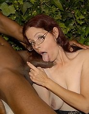 This mature slut loves to suck black cock in the garden